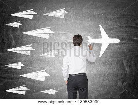 Man In Shirt Drawing Airplane