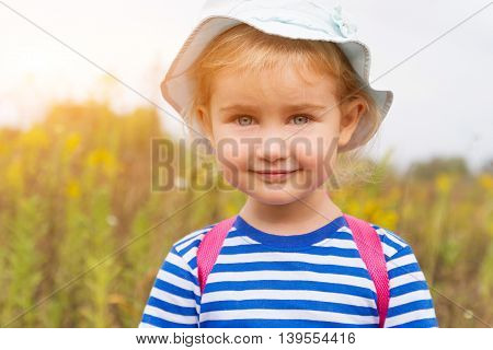 Cute Girl In Hat Smiling
