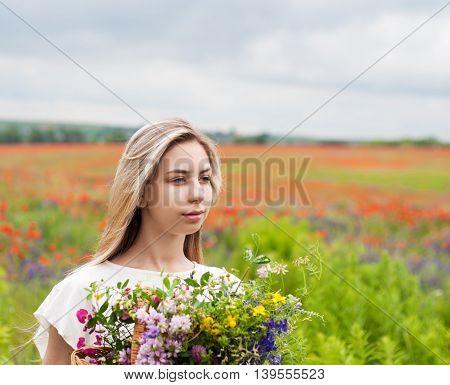 Beautiful Blonde Girl With Wildflowers
