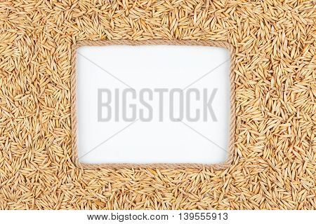 Frame made of rope with oat grains and a white background with space for your text