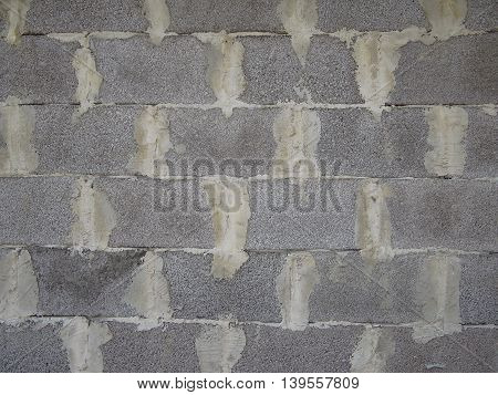 wall made of concrete blocks in gray, close-up