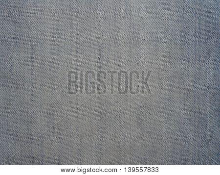 light blue denim fabric with fading, close-up