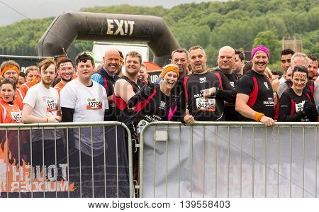 Grantham Leicestershire/UK - May 21, 2016: Members of the Full Support Barbaians wait at the entrance to the warm-up field ahead of the 2016 Tough Mudder extreme sports charity competition at Belvoir Castle.