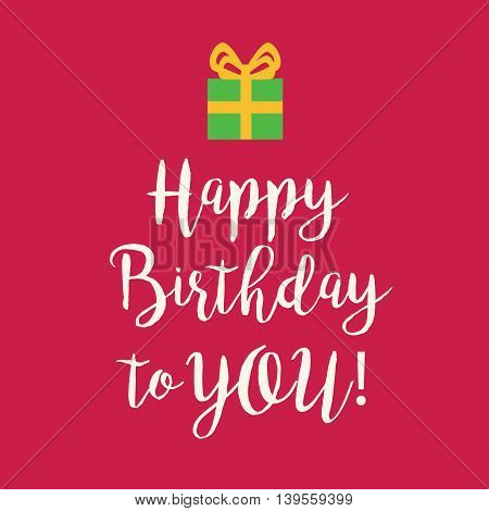 Cute Happy Birthday to You card with a handwritten text and an green wrapped birthday gift with orange ribbon bow on a pink background.