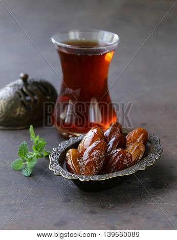 sweet dried dates in vintage silver plate
