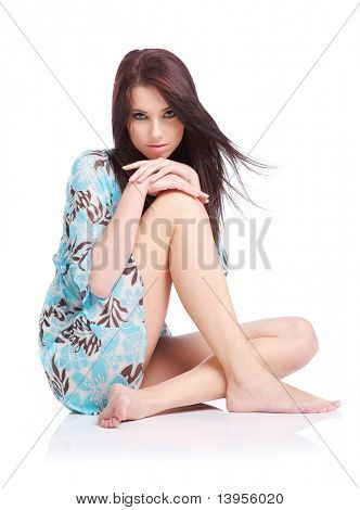 beautiful girl portrait sitting on the floor over a white background