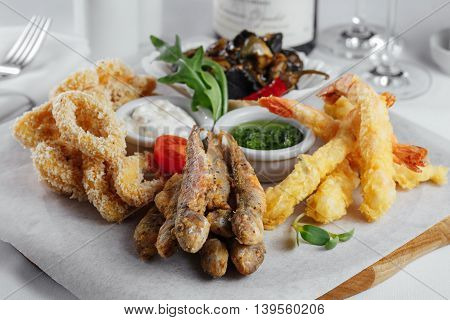 Squid Rings, Fried Fish, Mussels, Shrimp With Tomato Closeup