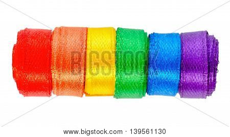 concept gay culture symbol with ribbons roll sign gay LGBT community is isolated on white background close up