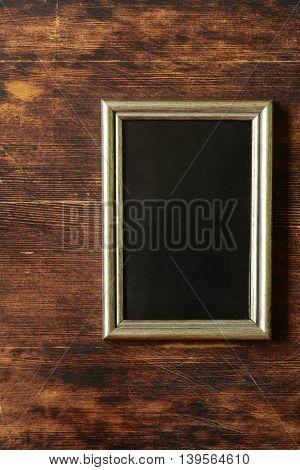 golden , vintage frame on wooden background