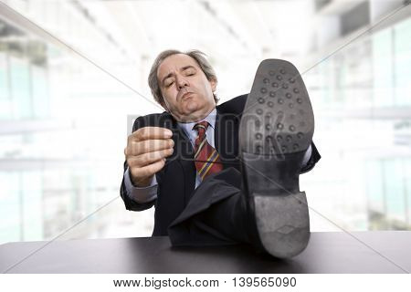 mature business man on a desk, at the office