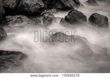 Motion Blur Water Surrounding Rocks, Black And White