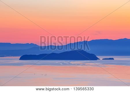 Sunset Over The Mountain With Reflection On The Sea