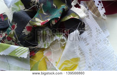 Mismatched scraps pieces of tattered fabric with lace