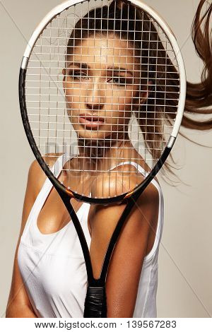 portrait of beautiful fitness sexy woman tennis player with racket