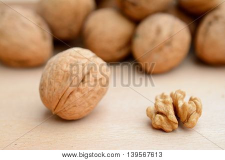 Walnut kernel and whole walnut closeup. Shallow depth of field.