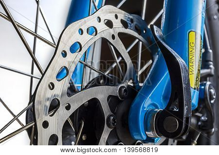 Close up shot of a cycle disc brake rotor