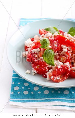 Tomato and feta cheese salad on plate