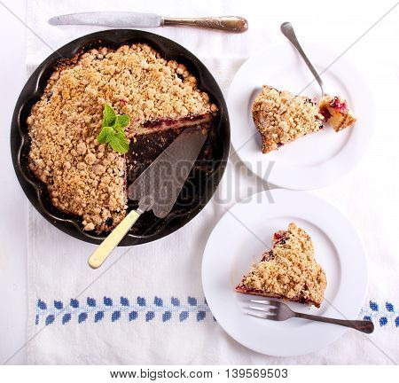 crumble topping cake sliced on plate top view