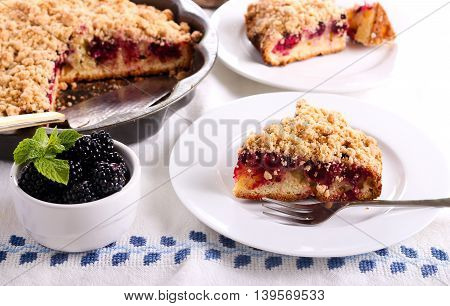 Blackberry crumble topping cake sliced on plate