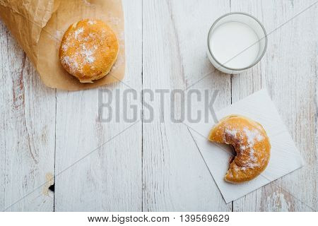 Bismarck Donut On Wooden Table In Paper