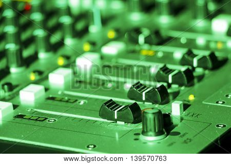 Close up shot of a professional DJ mixer in a club setting