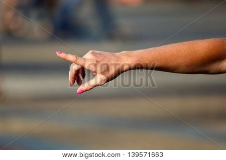 the women right hand on blurred background