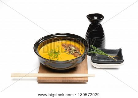Pumpkin cream soup arranged with Japanese decorations