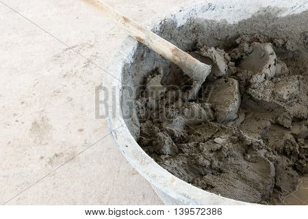 building construction wall. mix cement plaster concrete in bucket