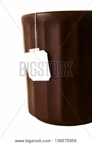 Brown chinese clay tea cup with tea bag on white isolated background