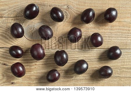 Plums on a wooden background,, top view
