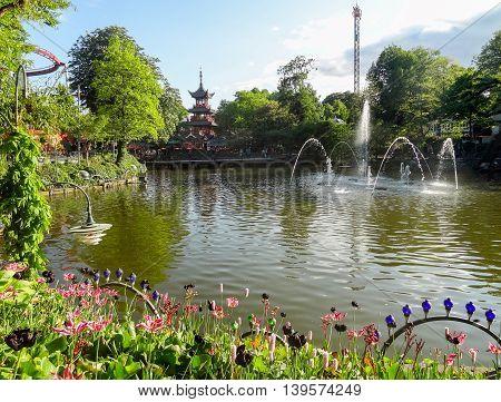 idyllic scenery around Tivoli Gardens in Copenhagen the capital city of Denmark