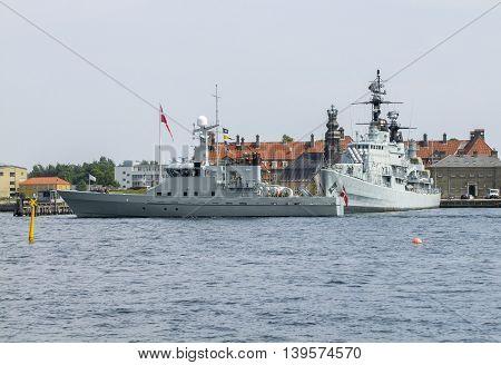 waterside scenery including some warships in Copenhagen the capital city of Denmark