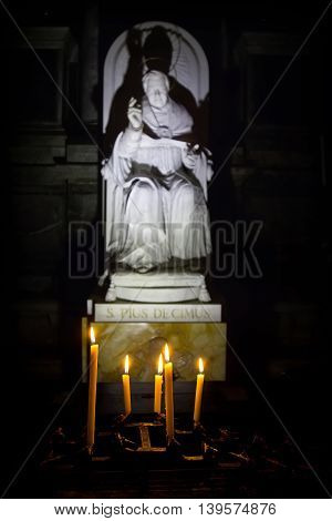 Venice - 12 November 2016: Candles in front of the statue Pope Saint Pius X in the church of San Salvador (the Holy Savior) Venice Italy