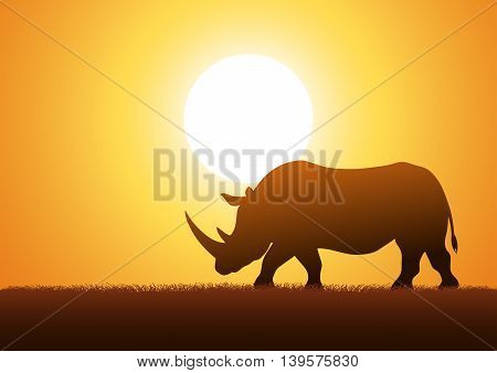 Silhouette illustration of a rhinoceros against sunset background
