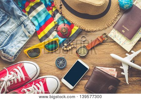 Travel accessories on wooden floor ready for travel