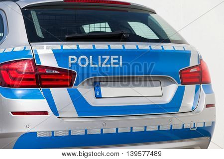 back from a german police car in blue