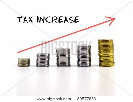 Conceptual Image. Stacks Of Coins Against White Background With Red Arrow And Tax Increase Words.