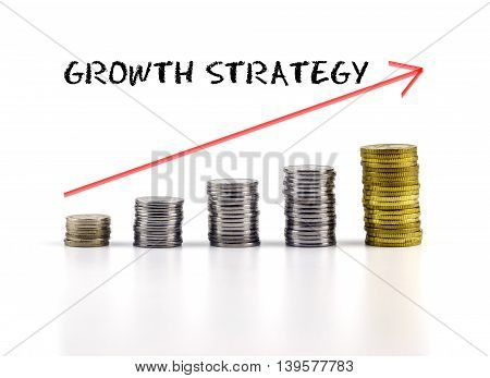 Conceptual Image. Stacks Of Coins Against White Background With Red Arrow And Growth Strategy Words.
