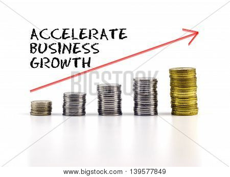 Conceptual Image. Stacks Of Coins Against White Background With Red Arrow And Accelerate Business Gr