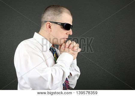 business man in white shirt with sunglasses holding hands in front of face