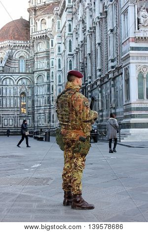 FLORENCE, Italy - January 19, 2016: cathedral Santa Maria del Fiore (Duomo) and soldier of special unit of the italian army  for the operation safe roads as prevention against terrorist attacks on January 19, 2016 Florence, Tuscany, Italy
