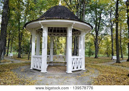 gazebo in the estate-museum Tarkhany Penza region of Russia on a background of fallen leaves in autumn public place