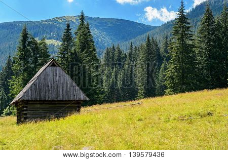 Small village cottage in the mountain valley.