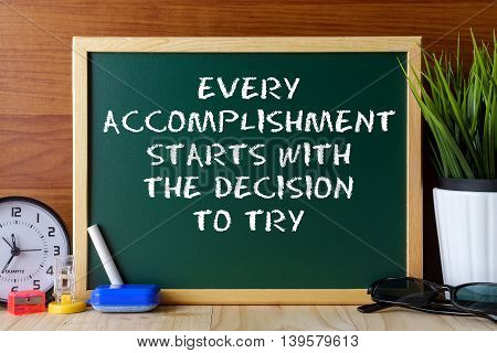 Word Quote Every Accomplishment Starts With The Decision To Try Written On Green Chalk Board On Wood