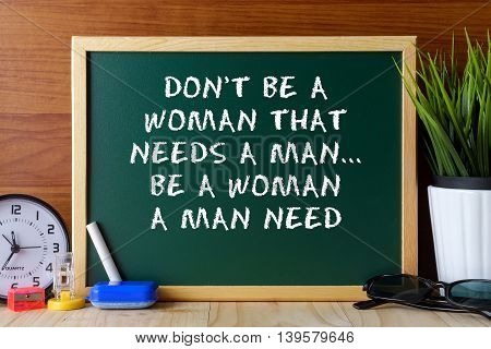 Word Quote Don't Be A Woman That Needs A Man,be A Woman A Man Need Written On Green Chalk Board On W