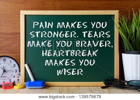 Word Quote Pain Makes You Stronger,tears Make You Braver,heartbreak Makes You Wiser Written On Green