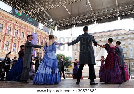 ZAGREB, CROATIA - JULY 23: Members of group Osijek 1862, Croatia in traditional city clothing of the 19th century during the 50th International Folklore Festival in Zagreb, Croatia on July 23, 2016