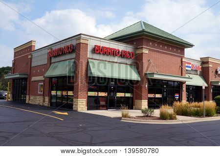 SHOREWOOD, ILLINOIS / UNITED STATES - AUGUST 30, 2015: One may eat burritos and other Mexican food at the Burrito Rico restaurant, in a Shorewood strip mall.