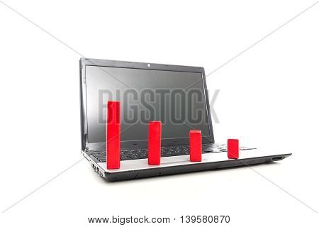 Down trend made of red blocks on the laptop. Trading workplace
