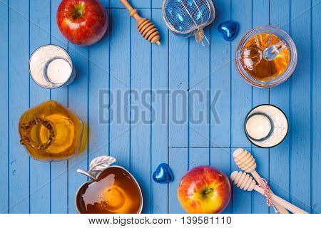 Wooden background with honey and apple for Jewish holiday Rosh Hashana. View from above. Flat lay